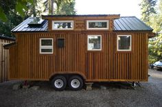 This tiny house, known as The Hope Cottage, is mobile, but it usually stays parked in its gorgeous natural setting in La Conner, WA.