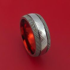 Damascus Steel Ring with Anodized Sleeve Custom Made Band