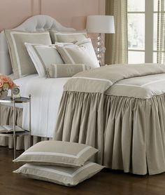 I  think this is the perfect blend of masculine and feminine. Love the color combo of walls and bedding.