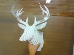 DIY Cardboard Deer head. These are stupid expensive online, I don't see why I can't make one with an old Utrecht folder and some spray paint... - LornaJean