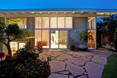 Buff, Straub & Hensman design, 1959. Dramatic view from the back patio at dusk.