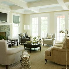 Liz Levin Interiors - living rooms - camel, traditional, sofa, black, caster, legs, sisal, rug, brown, leather, curvy, chairs, nailhead trim, espresso, round, modern, coffee table, stone, fireplace, ivory, rolled arm  chairs, French doors, zebra, bench, polished nickel, pharmacy floor lamps, coffered ceiling, TV, Arteriors Costello polished nickel side table,