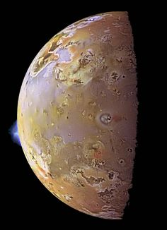 This color image of Io, acquired by the Galileo spacecraft in 1997, shows volcanic plumes on the bright edge of the moon, erupting over a volcanic depression named Pillan Patera. The plume rises some 140 kilometers (86 miles) high into space.  PHOTOGRAPH BY NASA/JPL/UNIVERSITY OF ARIZONA