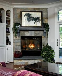 Split face elkstone fireplace and select bluestone slab hearth and mantel