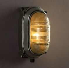 Crafted of ribbed prismatic glass and solid aluminum, our exacting reproduction of a French sconce dates to the Art Deco period. In the 1920s, yachtsmen equipped their boats with running lights just like this for night sailing or motoring, to help illuminate distant shores.