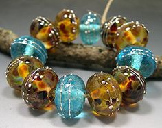 HANDMADE LAMPWORK GLASS Beads Donna Millard autumn fall winter blue gold brown Casa Grande. $45.00, via Etsy.