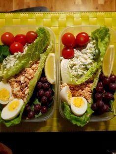 Salmon and egg salad with veggies and fruit.