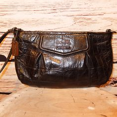 """Coach Black Croc Leather Large Wristlet Coach Black Croc Leather Large Wristlet, 9.5"""" x 6"""" x 1.5"""" with gunmetal gray hardware.  Excellent condition used twice only. Coach Bags Clutches & Wristlets"""