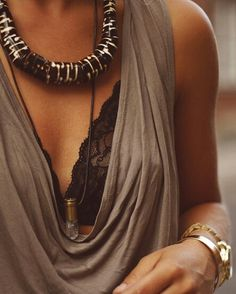 thick accent black tribal necklace with loose, scoop neck taupe / gray top. love it with the black lace bra and crystal necklace