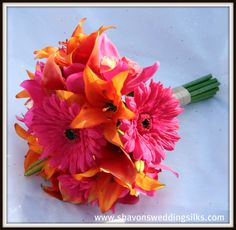 Bright pink Gerber daisies and orange tiger lilies... great bridesmaid's bouquet!   For mine, I'd love to have white lillies and light pink gerber daisies!!
