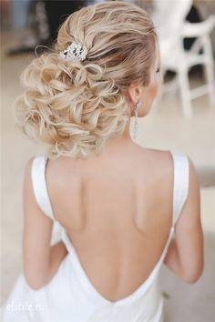 elegant messy wedding updo for long hair