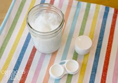 Homemade Eye Cream & Eye Makeup Remover  Ingredients: •1/2 cup organic extra virgin coconut oil •Vitamin E capsules •Lavender essential oil •pin to poke hole in the capsules •small container(s)  •A contact lens case for throwing into my makeup bag when traveling •a lip balm container for my purse •a small mason jar for my bathroom