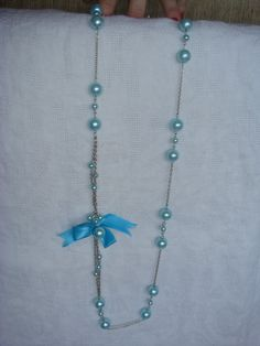 Blue long necklace with bow