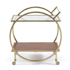 The Jameson Bar Cart is part of a line in Restoration Warehouse devoted to the importance of home, creature comforts, and things that make us feel safe that don't have to cost a fortune. It emphasizes the treasures that tie a house together and their direct link to your happiness. Restoration Warehouse is a selection of items that we find exciting and beautiful from around the world, and hope will inspire you and your clients.  Material: Brass, Glass, Lether