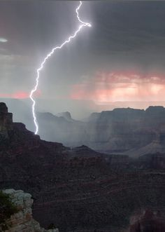 Grand Canyon view from Yavapai Point at sunset during a storm with a beautiful lightning. - Miguel Montesinos