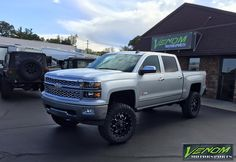 """Chevy Silverado with 6"""" Pro Comp, AMP PowerSteps, 20"""" Fuel Krank wheels, and 35"""" Toyo M/T tires."""