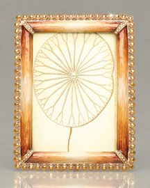 stone-edged frame with tiger's eye effect