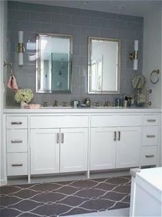 Add a runner, in front of your vanity to add some color.  Jennifer Taylor Design Blog: Decorating 101 - Easy Bathroom Updates