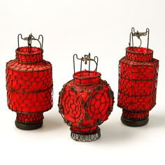 These little red Chinese lanterns are hand made using wire and canvas, with a wooden base. They make beautiful decorative objects and the shade on each one can be lifted up to place a tea light inside - Ideal for outside lighting.