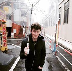 Still looks captivating even holding umbrella.