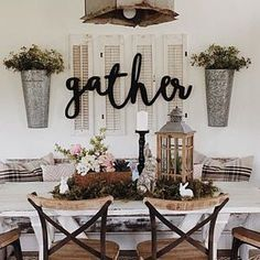 The Gather Sign I have on my shiplap dining room wall