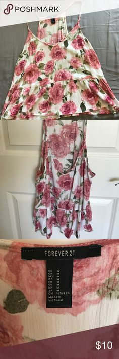Floral Tank Forever 21 This tank is very light. Not see through. Hits at the hips. Worn once or twice. Forever 21 Tops Tank Tops