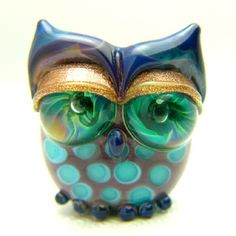 Peacock Owl I Trying to combine the colors of a peacock with the form of an owl. Gold Aventurine eyelids by Georgie Field
