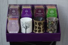 15 Scentsy bars and 3 Scentsy Plug In Warmers shown on our purple Stack Displays! www.StackDisplays.com