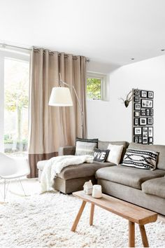 Nordic style living room in white, grey, black, and wood