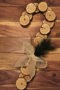 Place wood cookies onto painted pallet and spell out an address.  Would look really nice.