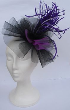 Black and purple facinator for the waitresses as this is what the Melbourne cup is all about for the women