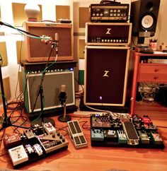 Guitar setup: Notice the Moogerfooger sitting quietly on the desk, and the original Roland Space Echo on top of the Dr Z head. Audio Studio, Home Studio Music, Guitar Effects Pedals, Guitar Pedals, Guitar Pedal Board, Space Echo, Recording Studio Design, Bass Amps, Guitar Building