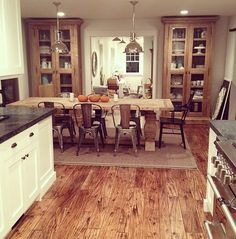 Soapstone countertops white cabinets, wood floor