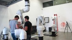 Students applying fittings and materials created using the 3D printer to the robotic arms (Photo: Phyllis Richardson)