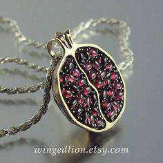 Bronze, silver, and garnet pomegranate necklace from WingedLion on Etsy. I had an idle thought about doing a modest version of this with garnet beads as the seeds Jewelry Box, Jewelry Accessories, Fashion Accessories, Jewelry Design, Unique Jewelry, Fashion Jewelry, Fall Jewelry, Summer Jewelry, Silver Jewellery