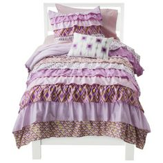 Castle Hill Bonaire Collection $24.99 - $89.99 Make your daughter's bedroom fashionably feminine with Castle Hill Bonaire Collection. This kids' bedding collection includes a darling ruffle quilt with contemporary overlapping prints. The sweet pinks, pale lavenders, vibrant purples and sunny yellows in this 100%-cotton girls' bedding collection are absolutely irresistible. Available in twin or full sizes.