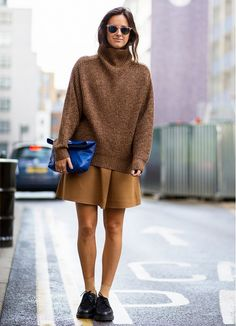 Neutral palettes are a fall must with tan sweaters and black lace up flats.
