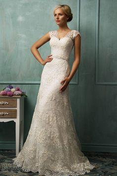 Romantic!!! love this bride's lace wedding dress. So elegant!