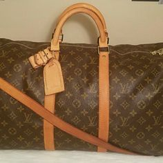 Louis Vuitton Keepall Bandouliere 50 I'm excellent condition. Only has some wrinkling and very minor cracks in the fold. The strap is in great condition with some light surface cracks. No dust bag included. Better price elsewhere. Louis Vuitton  Bags Travel Bags