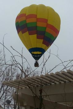 Hot air balloon over my house in the winter