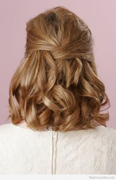Half up half down curly hairstyle for medium length hair