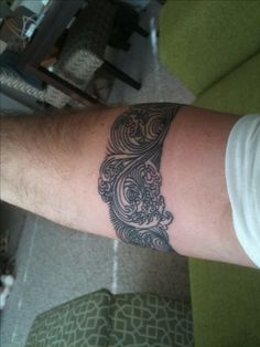 Robert Beer Tibetan waves forearm band tattoo