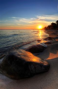Sunrise on Lake Huron. love how the smooth rock makes up the foreground and glows a soft orange where the sun hits it