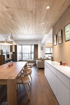 Apartments:Cozy Apartment Design With Sunny Wood Paneled Living Room Along With Wood Dining Table Also Dining Chairs Plus Pendant Lighting And White Cabinets Plus Cute Graphic Art And Laminate Wood Flooring Modern Apartment Design with Creative Wood Decorations
