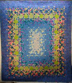Blooming nine patch in chartreuse and periwinkle with coral accents. 2011 Customer Quilts - Quilt Vine.