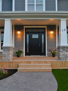 Black front door with sidelights and transom