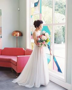 Instagram media by stylemepretty - With bright florals and killer style, this modern wedding is take-your-breath-away beautiful! | Photography: @greatromancephoto | Wedding Dress: @bhldn | Hair + Makeup: @e2beauty | Floral Design: @twigandtwine | Photo Booth: @drunkenpixel