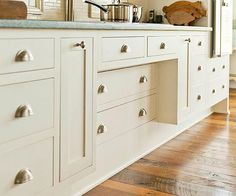Include recessed areas beneath the stove top and sink to allow people who use wheelchairs or other mobility devices to nudge right up to the work zones. The recessed areas can be outfitted with shallow cabinets so that you lose little storage space.
