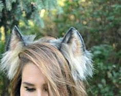 How to Make Wolf Ears. Wolves are a popular costume, and one of the most important aspects of a good wolf costume is a good set of ears. You can't just use any set of pointy, furry ears, or you may end up looking like a cat or fox! Girls Wolf Costume, Girl Werewolf Costume, Werewolf Ears, Werewolf Makeup, Halloween Tutu Costumes, Diy Costumes, Teen Costumes, Woman Costumes, Mermaid Costumes