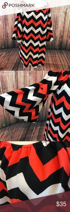 Bell Sleeve Boutique Chevron top/ dress- Medium Medium chevron dress/ top with bell sleeves - PERFECT FOR OVER LEGGINGS!!  black/ white/ peach? it's almost orange, but has a pink hue. Great for fall! Purchased at a local boutique, brand is Madeline Sparklestein. 95% Polyester 5% spandex Madeline Sparklestein Tops Tunics